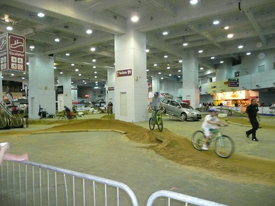 A dirt track in the middle of the exhibition centre.