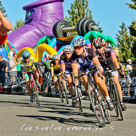Crit racing next to inflatable slides!