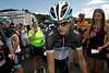 Two-time Tour de France runner-up Andy Schleck weaves his way through the gathered throng outside the Leopard-Trek team bus on Monday. Fans are able to walk up and touch their heros in cycling, even just minutes before they perform.