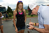 Laurel Rathbun of Monument gets an autograph from US cycling legend-turned-TV personality, Bob Roll, on Monday. Roll rode for the seminary 7-Eleven cycling team from the '80s, while Rathbun is, herself, a competitive cyclist, having ridden the Aspen Cross race in Estes Park last fall.
