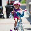 Nylizze Diaz, 2, makes her way up Main Street before the start of the kids races during the 55th annual Longsjo Classic in Fitchburg on Sunday afternoon. SENTINEL & ENTERPRISE / Ashley Green