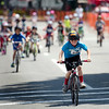 Michael Beaulac, 8, crosses the finish line in the kids race during the 55th annual Longsjo Classic in Fitchburg on Sunday afternoon. SENTINEL & ENTERPRISE / Ashley Green
