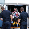 Their was a crash during the Woman's Pro 1 2 3 race at the Longsjo inWorcester on Saturday night . One of the racers is put into an ambulance. SENTINEL & ENTERPRISE/JOHN LOVE
