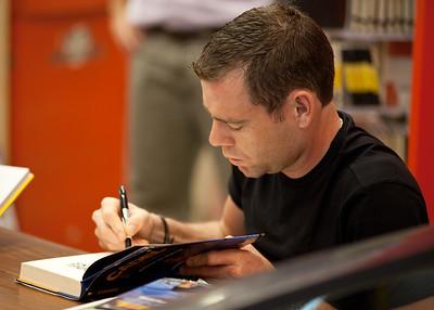 5x7: 2011 Tour de France cycling winner, Australian Cadel Evans - book signing at Dymocks Bookstore, Brisbane, Queensland, Australia; Monday 28 November 2011. Photos by Des Thureson.