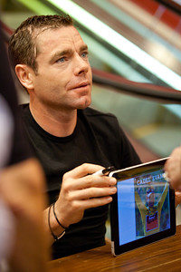 """""""How do you sign an iPad?"""" - 2011 Tour de France cycling winner, Australian Cadel Evans - book signing at Dymocks Bookstore, Brisbane, Queensland, Australia; Monday 28 November 2011. Photos by Des Thureson."""
