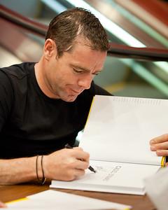 2011 Tour de France cycling winner, Australian Cadel Evans - book signing at Dymocks Bookstore, Brisbane, Queensland, Australia; Monday 28 November 2011. Photos by Des Thureson.