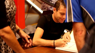 Short Video (8 seconds): 2011 Tour de France cycling winner, Australian Cadel Evans - book signing at Dymocks Bookstore, Brisbane, Queensland, Australia; Monday 28 November 2011. Photos by Des Thureson.