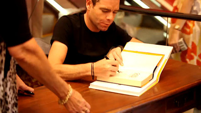 Short Video (17 secs): 2011 Tour de France cycling winner, Australian Cadel Evans - book signing at Dymocks Bookstore, Brisbane, Queensland, Australia; Monday 28 November 2011. Photos by Des Thureson.