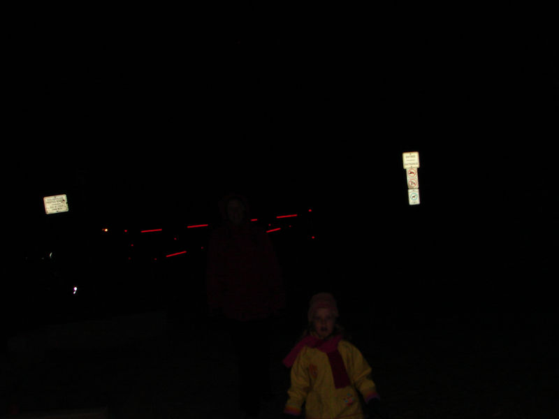 Spectators and cheering family in the dark november park.