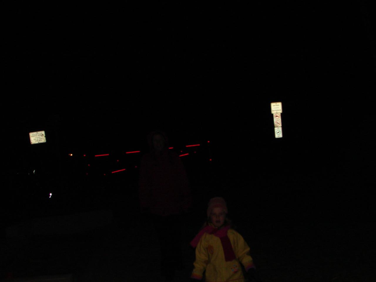 Spectators and cheering family in the dark november park.
