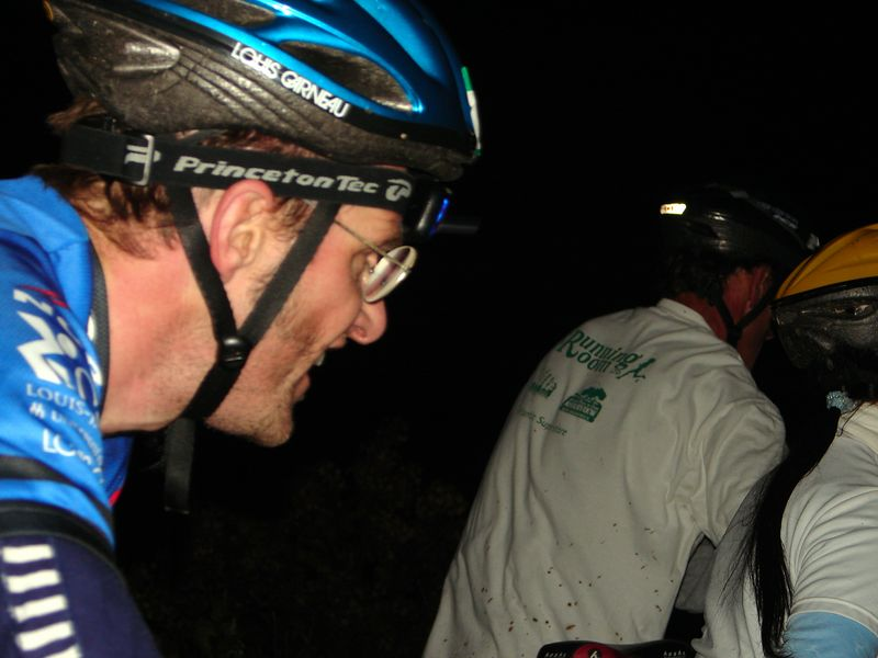 "Ian ""el Diablo eyes"" Dennis overtaking Roger and Sherry at the mandatory dismount over the railroad ties."