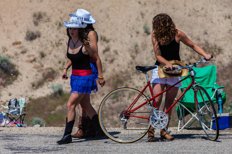 These two cowgirls were actually racers who got disqualified yesterday for finishing outside the time cut. They decided to dress up to cheer on their teammates and later rode back on their race bikes with their race number still on the bike but still in these outfits!