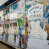 The windows at the former Harper Furniture have been plastered with Longsjo Classic photos in preparation for this year's race to be held June 24, 25 and 26. SENTINEL & ENTERPRISE / Ashley Green
