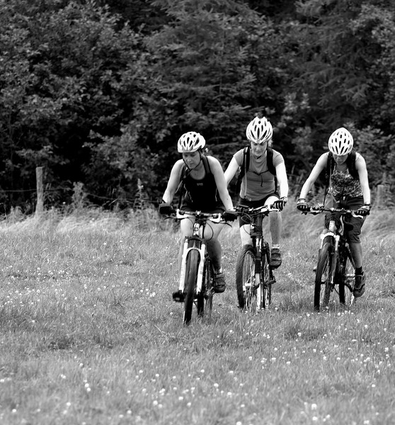 in a drizzled pre ride the girls emerge from the dark forest.