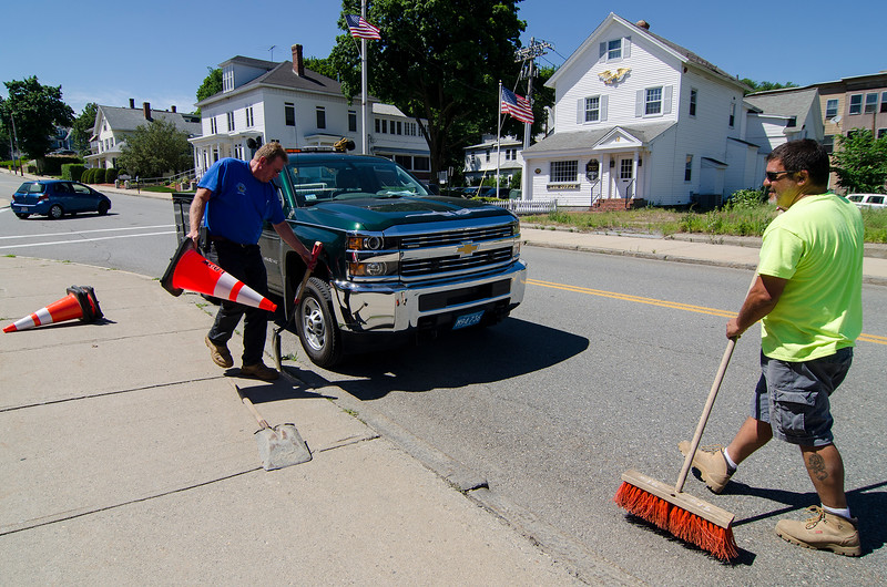 David Smith and Kevin Iannacone, both of the Leominster DPW, work on the course on Merriam Ave. on Tuesday afternoon ahead of Friday evening's Longsjo Classic Twilight Criterium. SENTINEL & ENTERPRISE / Ashley Green