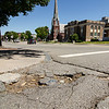 Potholes seen on School St. in Leominster ahead of Friday evening's Longsjo Classic Twilight Criterium. SENTINEL & ENTERPRISE / Ashley Green