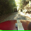 Through the train tunnel heading towards Rockmart GA. A great stretch of path.<br /> Some parts of this video are better then others, but generally this is a 1-2% drop over along stretch. Great sunrise behind me as the trees are just starting to turn. I picked up something and felt the backend getting soft... then a flat.