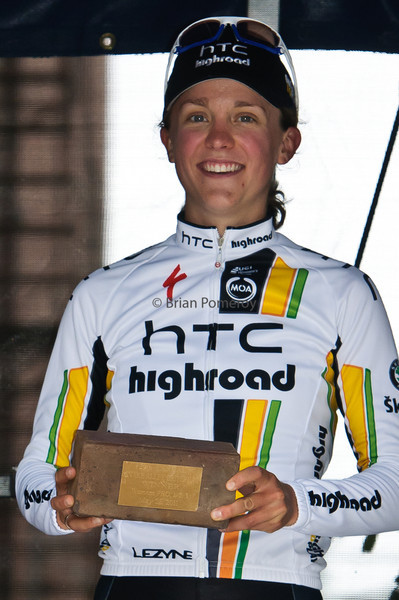 Winner of the 2011 Snake Alley Criterium, Amanda Miller of HTC Highroad stands is awarded the winner's brick.