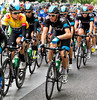 Sir Bradley Wiggins (left) safely surrounded by his Sky teammates