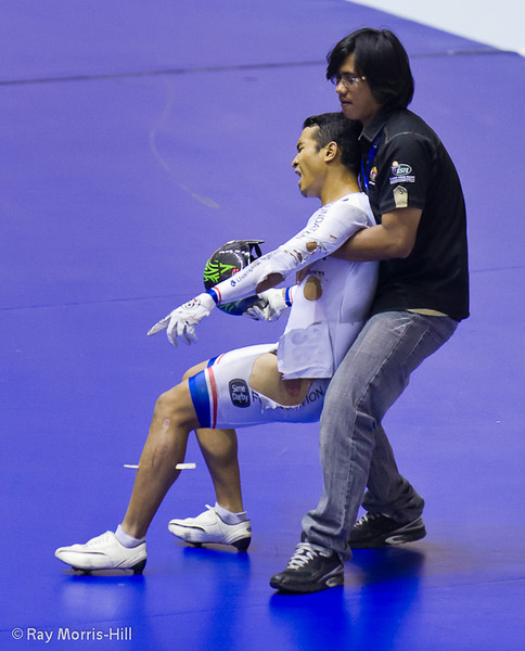 Malaysian cycle ace Awang after winning bronze in the Men's Keirin and picking up a splinter