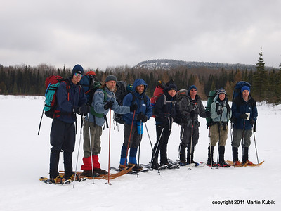 The expedition recruits.  Eagle Mtn. in the background.