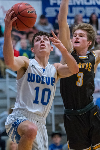 Fremont's Baylor Harrop (10) drives the ball into the paint, against Davis defender Jake Sampson (3). During the prep basketball game against Fremont Hight School. In Plain City, on Friday January 3, 2020.
