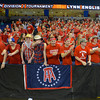 RYAN HUTTON/ Staff photo.<br /> Central Catholic fans get fired up as their team scores the first basket against Lynn English during Saturday night's game at the Tsongas Center in Lowell.