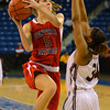 Centeral Catholic's Amanda Willams (5) tries to put up a shot over English's Deidra Newson (34) during the first half of Saturday night's game at the Tsongas Center in Lowell.<br /> Photo by Ryan Hutton.