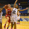 RYAN HUTTON/ Staff photo.<br /> Centeral Catholic's Amanda Willams (5) tries to put up a shot over English's Deidra Newson (34) during the first half of Saturday night's game at the Tsongas Center in Lowel.