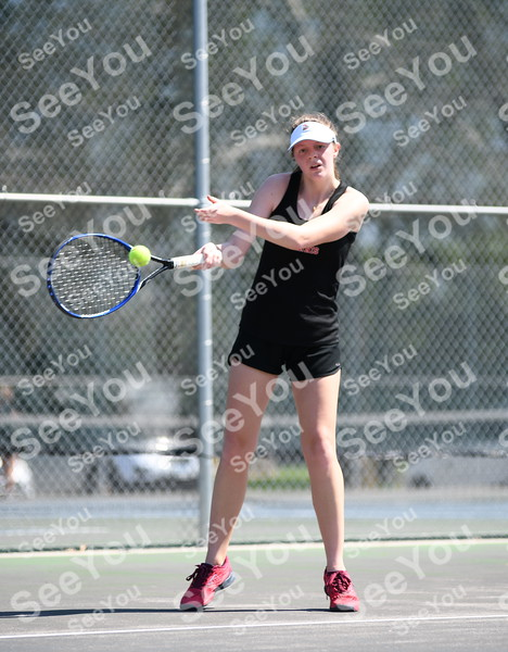-Messenger photo by Britt Kudla<br /> Kathryn Cochrane of Fort Dodge compete against Dowling Sofia Sackett during Class 4A Districts on Wednesday at Dodgers Courts