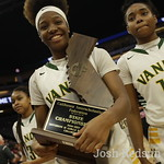 Vanden's Aryel Moreland walks the trophy from the game against Mater Dei Monarchs at the Girls Basketball State Championships at Golden 1 Center in Sacramento,Saturday, (Josh Redsun/Daily Re ...