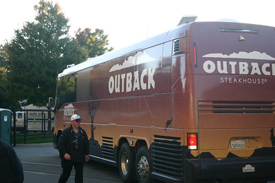 John Madden's Outback Steakhouse cruiser pulls into one of the secure parking lots.
