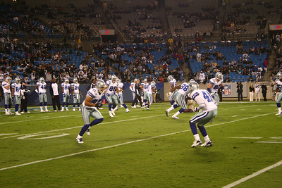 Terry Glenn left, Terence Newman right, as Romo throws passes to the outside.