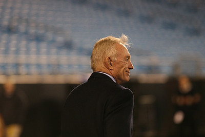 Cowboys Owner Jerry Jones appears, greeting a small group near the Cowboys' sidelines.
