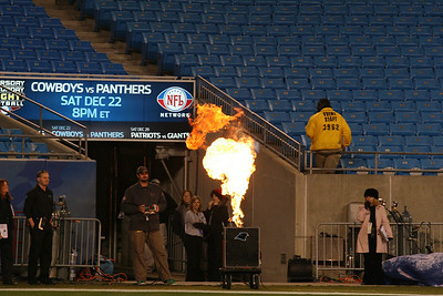 The Special Effects Team adjust and prepare their propane-fed explosion effect for the introduction of the Carolina Panthers.