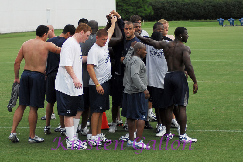 The guys huddle it up before calling it a day.  I think something was said about a Superbowl. ; )