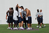 The big guys huddle up after the workout.  Something was said about a Superbowl.  ; )