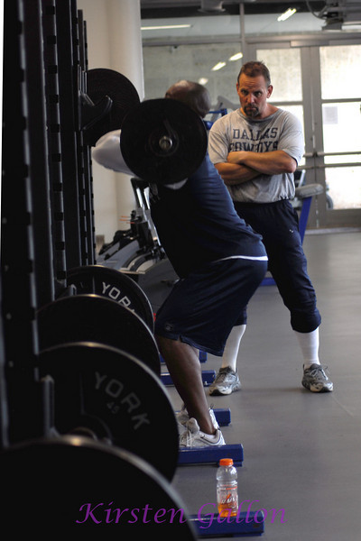 Joe observes as Akin Ayodele, a linebacker rehabilitating his knee from an injury last season, does his squats.