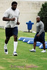 Greg Ellis, a linebacker, ten year veteran and one of the few remaining guys from the days when I did fitness work with them, makes his way through the obstacle course.  Greg's off-season work ethic is a main ingredient in his longetivity in this league.  Assistant coach Phil Penn keeps watches from behind.