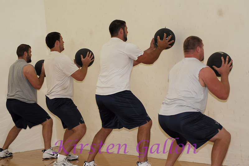More medicine ball work.  The guys are from left to right:  Trey Darilek, Jim Marten, Doug Free, and Cory Proctor.