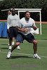 Doug Free, an offensive tackle, takes his turn during the cone drill.  Assitant coach Tony Ollison watches from behind.