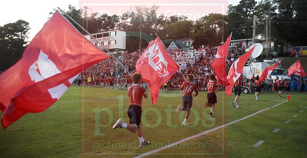 Matt Hamilton/Daily Citizen-News<br /> Dalton students celebrate a Catamount score by running with flags that spell out DALTON in the endzone on Friday.