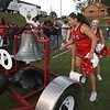 Matt Hamilton/Daily Citizen-News<br /> Dalton High cheerleaders ring the bell after a score.