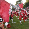 Matt Hamilton/Daily Citizen-News<br /> The Cats burst through their banner on Friday.