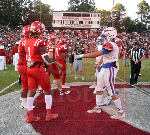 Matt Hamilton/Daily Citizen-News<br /> Dalton and Northwest players shake hands after the coin toss Friday.