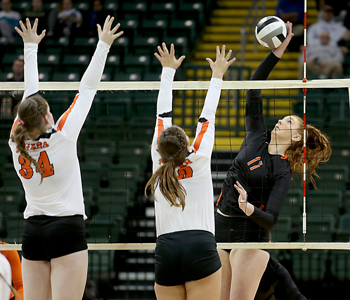 E.L. Hubbard / Special to GateHouse Ohio Media<br /> Dalton MH Emma Granger tries to score against Jackson Center's Alicia Kessler and Kamryn Elchert during their Division IV semifinal at Wright State's Nutter Center in Fairborn Friday, Nov. 11, 2016.