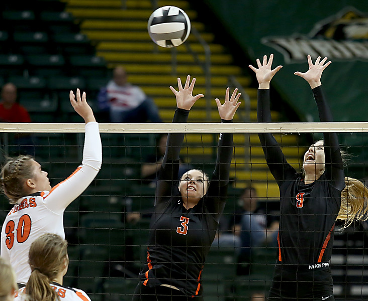 E.L. Hubbard / Special to GateHouse Ohio Media<br /> Dalton S Lauran Hicks and MH Cortney Carathers go up to block the shot of Jackson Center's Vanessa Winner during their Division IV semifinal at Wright State's Nutter Center in Fairborn Friday, Nov. 11, 2016.