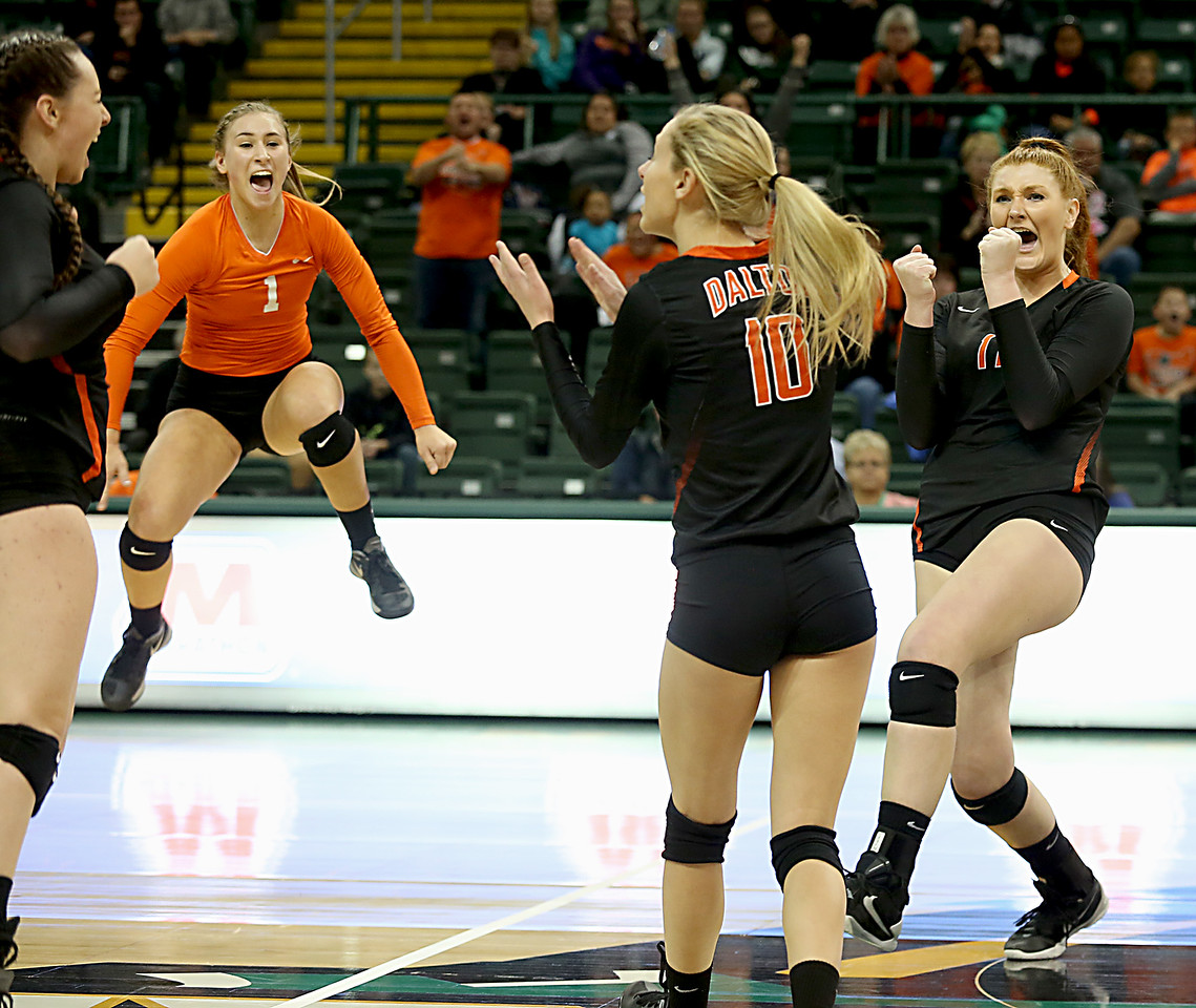 E.L. Hubbard / Special to GateHouse Ohio Media<br /> Dalton teammates Lauran Hicks, Kelsey Shoup, Katie Huth, and Emma Granger celebrate a point against Jackson Center during their Division IV semifinal at Wright State's Nutter Center in Fairborn Friday, Nov. 11, 2016.