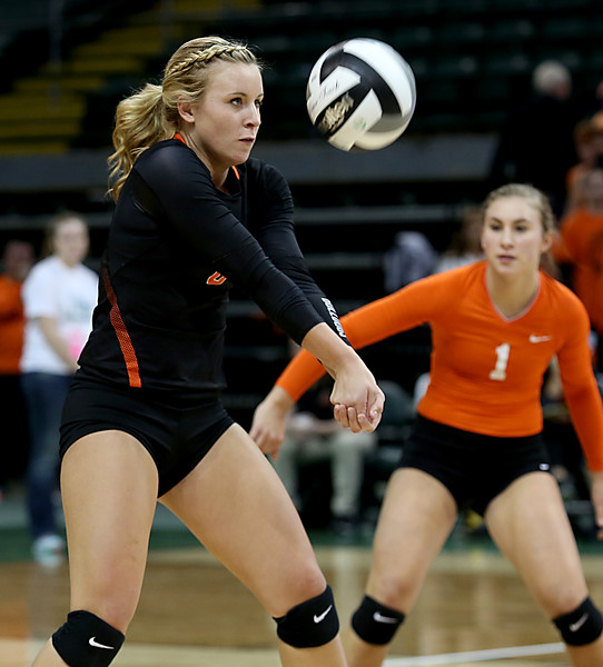 E.L. Hubbard / Special to GateHouse Ohio Media<br /> Dalton MH Kirsten Shoup returns a volley to Jackson Center during their Division IV semifinal at Wright State's Nutter Center in Fairborn Friday, Nov. 11, 2016.
