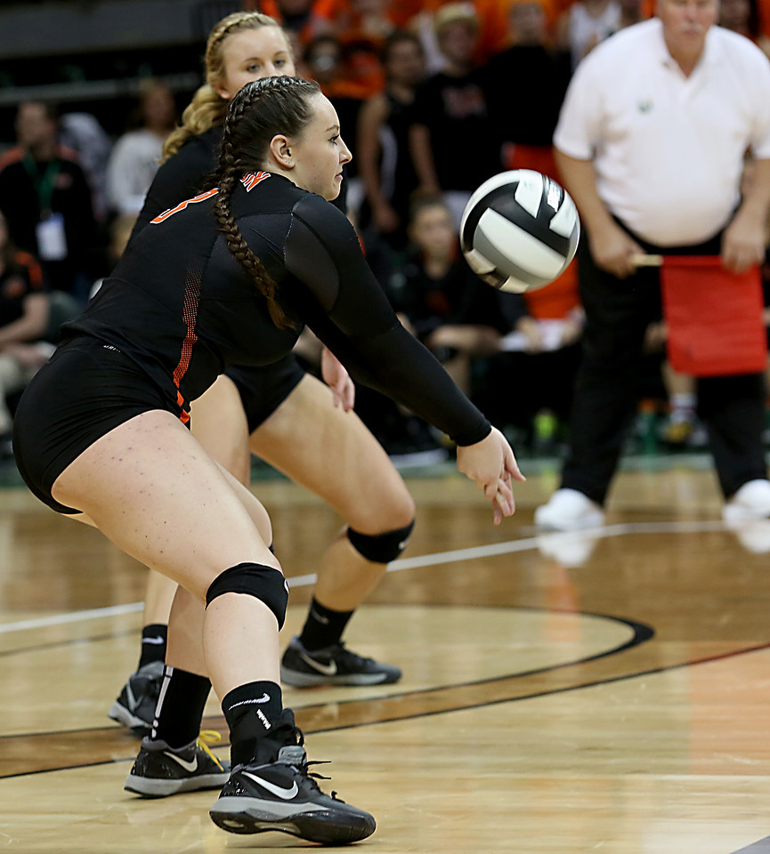 E.L. Hubbard / Special to GateHouse Ohio Media<br /> Dalton S Lauran Hicks returns a serve to Jackson Center during their Division IV semifinal at Wright State's Nutter Center in Fairborn Friday, Nov. 11, 2016.